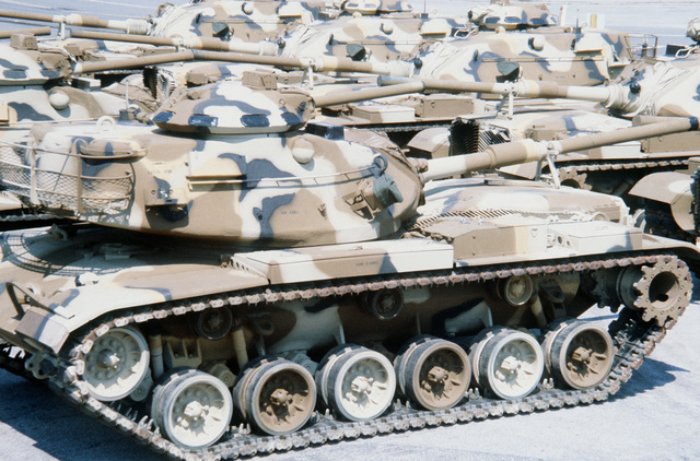 A view of Marine M-60A1 tanks parked in a staging area prior to being placed aboard a ship in support of the possible rapid deployment of a 12,000-troop amphibious brigade operation. Marines from the 2nd Force Service Support Group are performing the work