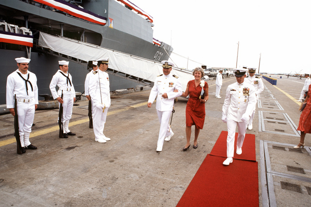 Mrs. June Baldwin, sponsor and wife of retired Vice Admiral Robert Baldwin, arrives for the commissioning of the fleet oiler USS MONONGAHELA (AO 178). She is escorted by Commander (CDR) Albert Bard, prospective commanding officer