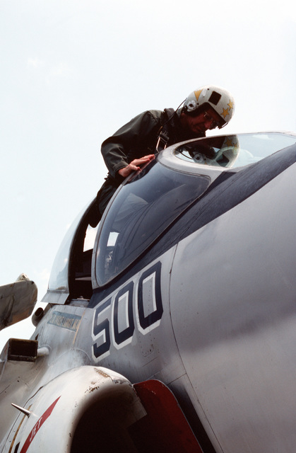 Admiral Thomas B. Hayward, CHIEF of Naval Operations, climbs into the cockpit of the A-6 Intruder aircraft that will take him to the aircraft carrier USS MIDWAY (CVA 41) for a visit