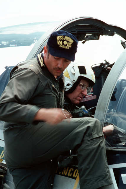 Admiral Thomas B. Hayward, CHIEF of Naval Operations, talks to a flight captain prior to take-off in the A-6 Intruder aircraft that will take him to the aircraft carrier USS MIDWAY (CVA 41) for a visit