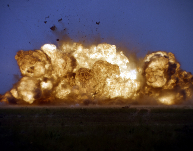 A fireball from a GBU-24 low-level laser-guided bomb at it explodes on its target, a moving truck. The bomb was launched 2 1/2-miles away on Eglin Range C-52N by the 3246th Test Wing