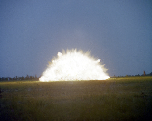 The initial explosion for a GBU-24 low-level, laser guided bomb as it explodes on its target, a moving truck. The bomb was launched 2 1/2-miles away on Eglin Range C-52N by the 3246th Test Wing