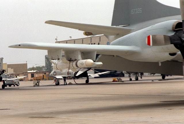 A view of a Harpoon missile on the right wing of a P-3 Orion aircraft. The P-3 has a special paint scheme for use during a Harpoon missile visibility test on infrared video
