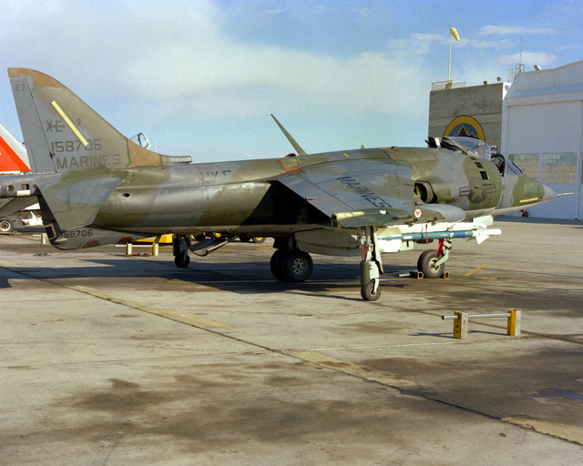 Naval Weapons Center. A right side view of a Marine AV-8 Harrier aircraft armed with a Sidearm missile