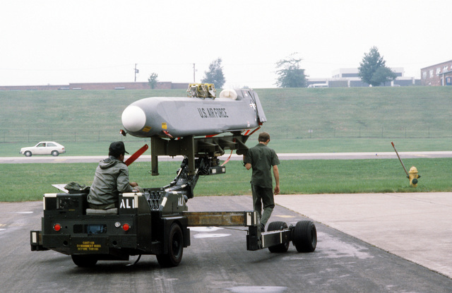 The missile crew from the 416th Bomb Wing, transports an Air-Launched Cruise Missiles for mounting to the pylon of a B-52G Stratofortress aircraft