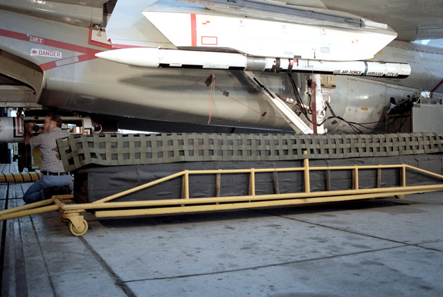 A ground ejection test is performed on an F-14A Tomcat aircraft armed with an advanced medium range air-to-air missile (AMRAAM) at the Pacific Missile Test Center