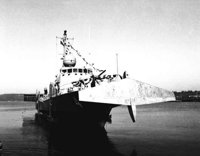 A starboard view of the guided missile patrol combatant (hydrofoil) AQUILA (PHM-4) in the water following its launching. The AQUILA was built by Boeing Marine Systems