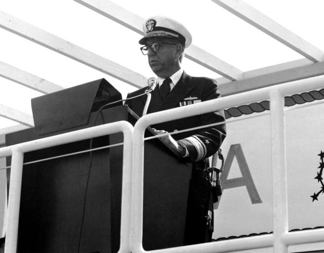 RDML James W. Lisanby, deputy commander, Ship Design Integration, Navy Sea Systems Command, speaks at the launching of the guided missile patrol combatant (hydrofoil) AQUILA (PHM-4). The AQUILA was built by Boeing Marine Systems