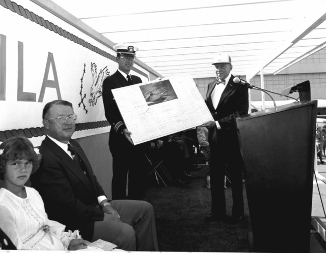 Retired LT J. M. Newberry, USN, right, presents LCDR David M. Lee, prospective commanding officer of the guided missile combatant (hydrofoil) AQUILA (PHM-4), with a plaque on behalf of the PT-boat Society