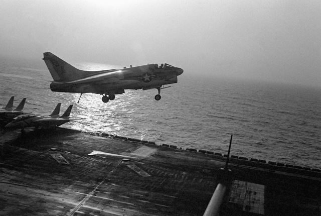 An A-7 Corsair II aircraft from Light Attack Squadron 72 (VA-72) comes for a landing aboard the nuclear-powered aircraft carrier USS NIMITZ (CVN-68) during the NATO exercise Display Determination '81