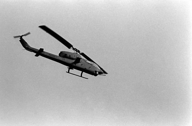 An air-to-air right side view of an AH-1 Sea Cobra helicopter during the NATO exercise Display Determination '81