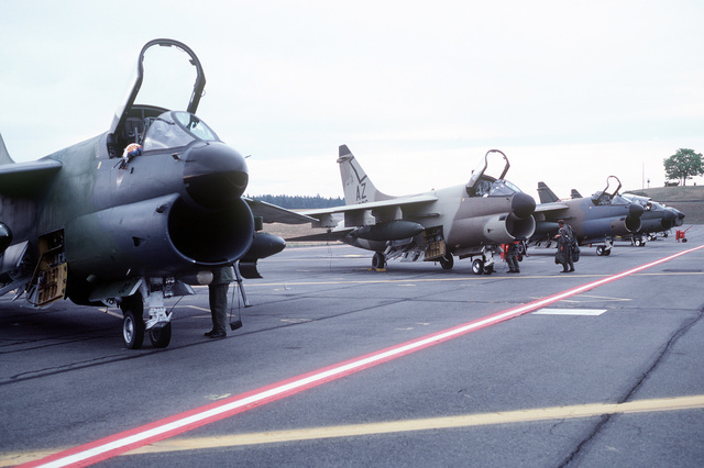 Arizona National Guard prepare their A-7D Corsair II aircraft for flight. The aircraft, each in a different camouflage paint scheme, will be tested against forest and desert backgrounds for visibility