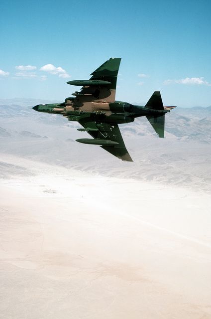 A underside view of an F-4 Phantom II aircraft as it banks to the right, while on a practice bombing run during Operation Gunsmoke '81