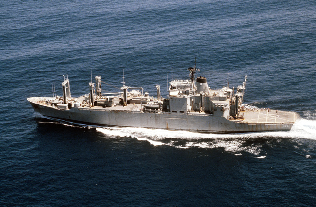 Aerial port beam view of the ammunition ship USS MOUNT HOOD (AE-29) en route to Cayalan Island, Philippines, the location of the capsized Philippine destroyer escort ship DATU KALANTIAW, during Aerospace Rescue and Recovery Squadron (ARRS) operations