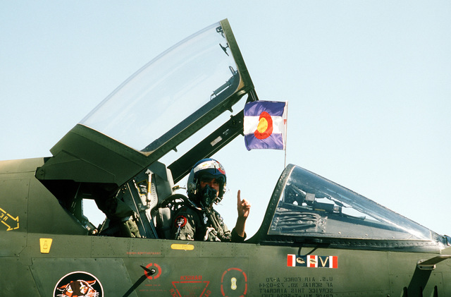 "An A-7 Corsair II aircraft pilot from the Colorado ""Tiger"" guard displays his colors upon arrival during Operation Gunsmoke '81"