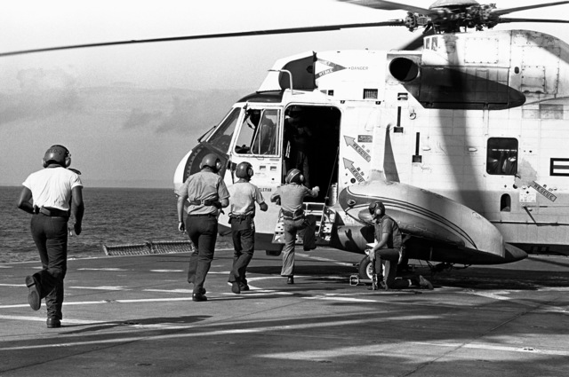 Crewmen aboard an SH-3A Sea King helicopter, from Fleet Composite Squadron 5 (VC-5), aboard the ammunition ship USS MOUNT HOOD (AE-29) during search and rescue (SAR) operations for the beached and overturned Filipino frigate RPS DATU KALANTIAW (PS-76). The frigate was overtaken by Typhoon Clara