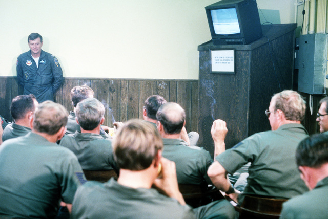 Gunsmoke '81 maintenance troops view the bombing range action via closed circuit video in a conference room on the main base