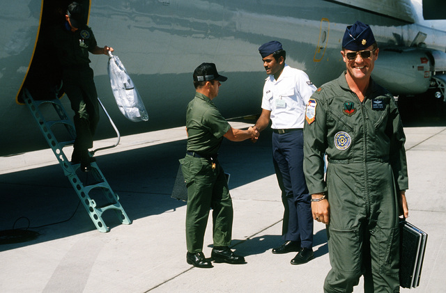 Korean ally team members and ground crewmen disembark a C-141 Starlifter aircraft upon its arrival during Operation Gunsmoke '81
