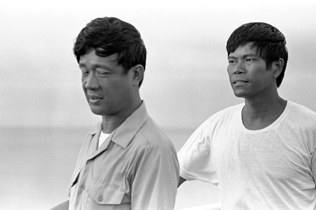 LT Luis D. Decanay, left, and CHIEF Electronic Technician (ETC) Francisco B. Nonisa, both of the Philippine navy and both survivors of the typhoon-damaged Filipino frigate RPS DATU KALANTIAW (PS-76), stand aboard the USS MOUNT HOOD (AE-29) while being transported from their wrecked ship on Calayan Island to Manila. The men were just picked up during search and rescue (SAR) operations