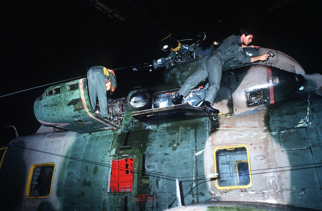 SSGT Carlton Johnson performs pre-flight maintenance on an HH-3 Jolly Green Giant helicopter, for use in Aerospace Rescue and Recovery Squadron (ARRS) operations of the DATU KALANTIAW, a Philippine destroyer escort ship which capsized on Cayalan Island