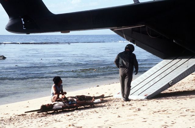 SSGT Charles Sumerlin of the Aerospace Rescue and Recovery Squadron (ARRS) stands by to load a DATU KALANTIAW survivor aboard an HH-3 Jolly Green Giant helicopter, after the Philippine destroyer escort ship capsized