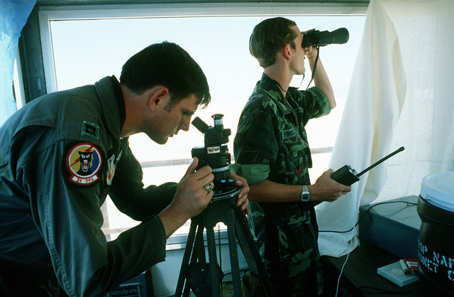 Tower observers at a bombing range relay target information back to the scoring team on the main base during Operation Gunsmoke '81