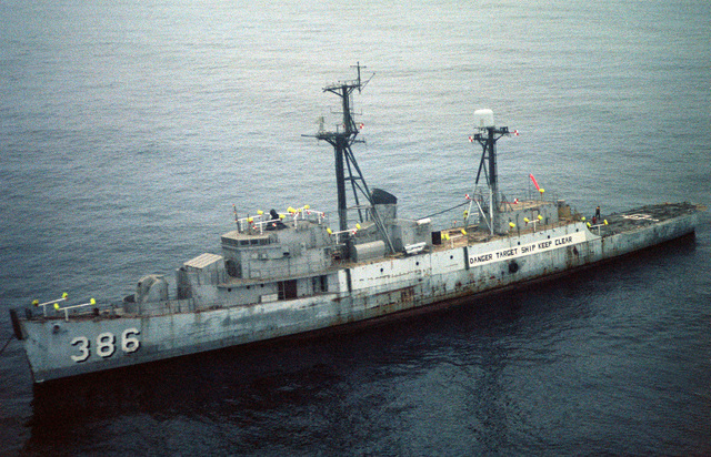 An aerial port bow view of the target destroyer ex-USS SAVAGE with cameras and antennas positioned on its decks, for use during the High Altitude Anti-Radiation Missile (HARM) project at the Pacific Missile Test Center