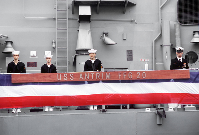 A partial view of the guided missile frigate USS ANTRIM (FFG-20) as crewmen man the rails during commissioning