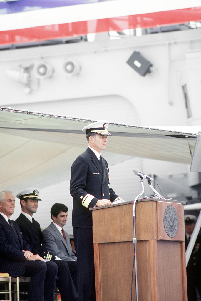 RDML James D. Williams, commander, Naval Base, Seattle, Wash., speaks during the commissioning of the guided missile frigate USS ANTRIM (FFG-20)