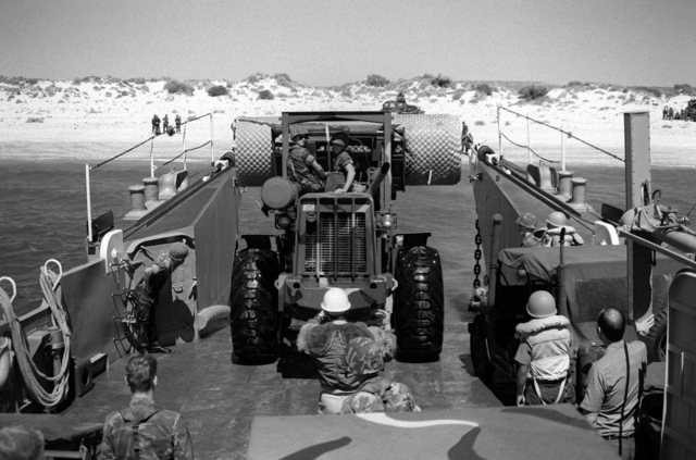 A Marine backs a forklift onto a mechanized landing craft (LCM-8) prior to the 31st Marine Amphibious Unit's participation in Kangaroo 4 (1981)