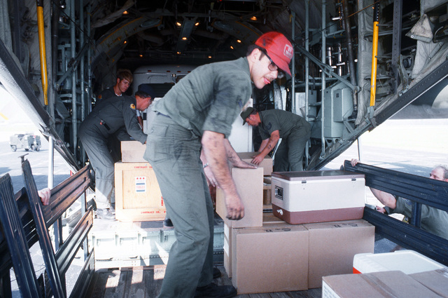 Miscellaneous supplies for the mobile Personnel Support for Contingency Operations (PERSCO) van are loaded aboard a C-130 Hercules aircraft