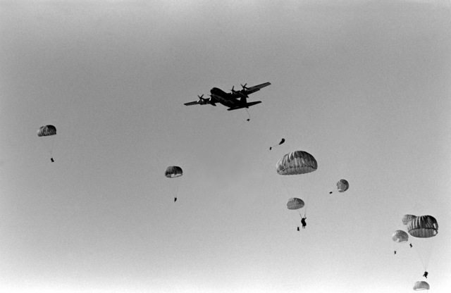 A mass parachute drop from a 37th Tactical Airlift Squadron C-130 Hercules aircraft, Rhein-Main Air Base, Germany, takes place during Exercise Crisex '81