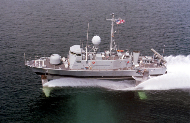 A port beam view of the guided missile patrol combatant (hydrofoil) TAURUS (PHM-3) underway on its hydrofoils. The ship was built by Boeing Marine Systems