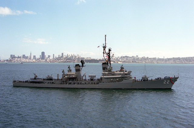 A starboard beam view of the guided missile destroyer USS BENJAMIN STODDERT (DDG-22), with crew members manning the rail during Fleet Week activities. Visible in the background the San Francisco skyline