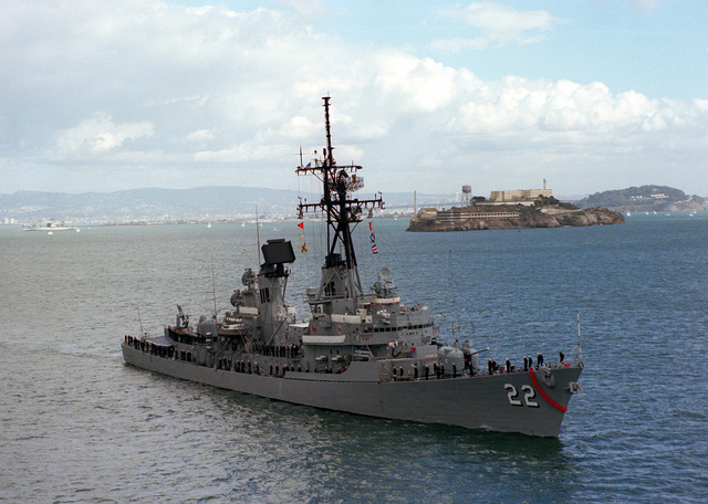 A starboard bow view of the guided missile destroyer USS BENJAMIN STODDERT (DDG-22), with crew members manning the rail during Fleet Week activities. Visible in the background is Alcatraz Island