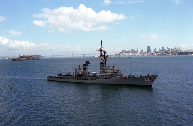 A starboard bow view of the guided missile destroyer USS BENJAMIN STODDERT (DDG-22), with crew members manning the rail during Fleet Week activities. Visible in the background are Alcatraz Island, the San Francisco-Oakland Bay Bridge, and the San Francisco skyline