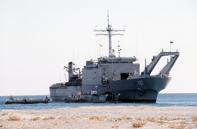 A starboard bow view of the tank landing ship USS BARNSTABLE COUNTY (LST-1197), after landing on the beach during Exercise Crisex '81
