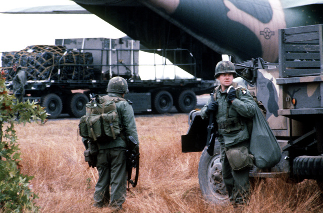 A truck and equipment attached to the 101st Airborne Division, is offloaded from the ramp of a C-130 Hercules aircraft during exercise BOLD EAGLE '82