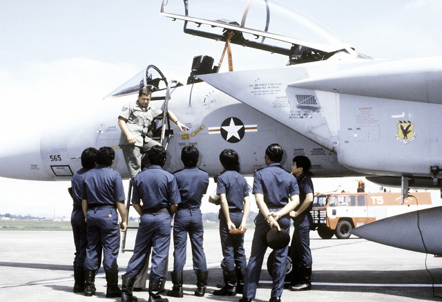 A U.S. Air Force technical sergeant briefs Royal Singapore Air Force (RSAF) fire department/crash rescue personnel on F-15 Eagle aircraft rescue procedures. The U.S., Australian and Singapore Air Forces are taking part in a joint operation at the conclusion of exercise Kangaroo '81