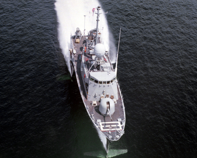 A vertical view, looking toward the stern, of the guided missile patrol combatant (hydrofoil) TAURUS (PHM-3) underway on its hydrofoils. The ship was built by Boeing Marine Systems
