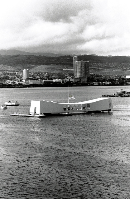 An exterior view of the USS ARIZONA MEMORIAL with Aiea in the background