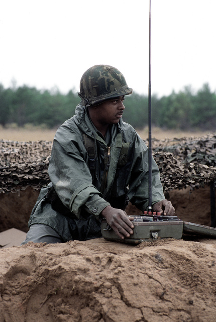 Army CPL Kevin Lambright uses a Target Alert Data Display to detect enemy aircraft, and determine the direction that they would be approaching from during exercise Bold Eagle '82