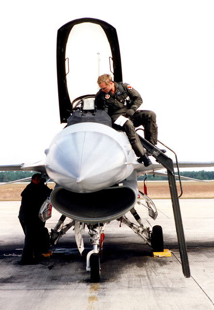 Captain Steve Duresky, 388th Tactical Fighter Wing, inspects the cockpit of an F-16 Fighting Falcon aircraft, prior to flight during exercise BOLD EAGLE '82