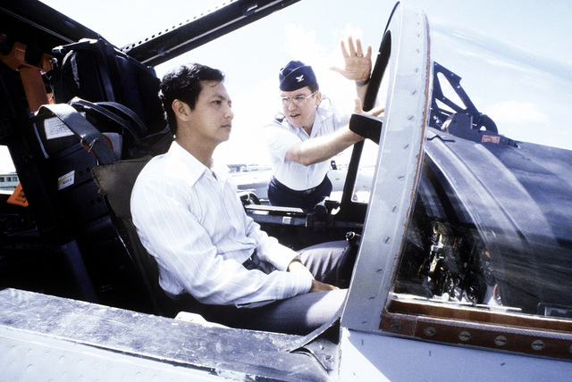 COL W.R. Macfarlane, from the 18th Tactical Fighter Wing, explains the F-15 Eagle aircraft to Singapore Minister of State Yeo Ning Hong. The U.S., Australian and Singapore Air Forces are taking part in a joint operation at the conclusion of exercise Kangaroo '81