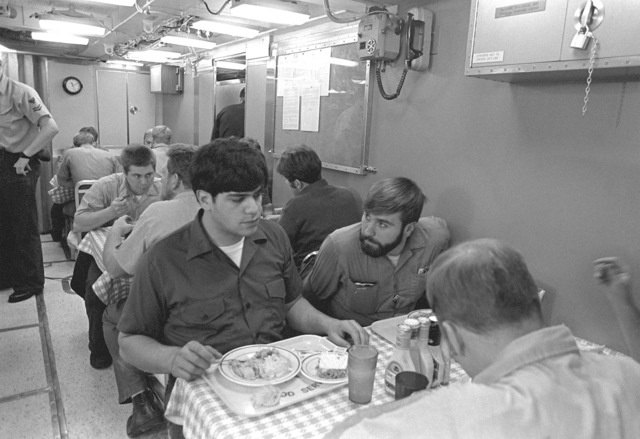 Crewmen eat in the dining hall during precommissioning duty aboard the nuclear-powered ballistic missile submarine OHIO (SSBN-726)