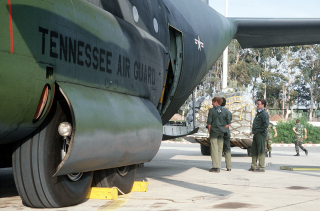 Members of the 105th Tennessee Air National Guard prepare a C-130 Hercules aircraft for the transport of personnel to Rhein-Main Air Base, West Germany, during Exercise Crisex '81