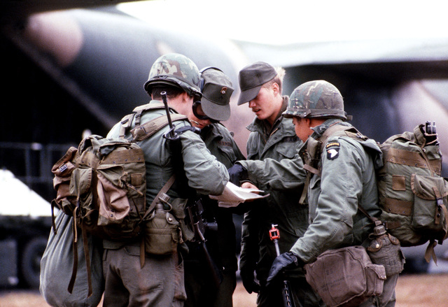 Men from the 101st Airborne Division, assemble by the loading ramp of a C-130 Hercules aircraft during exercise BOLD EAGLE '82