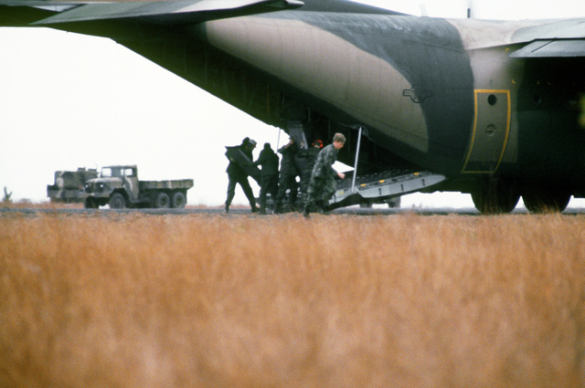Men from the 101st Airborne Division, prepare for exiting from the ramp of a C-130 Hercules aircraft during exercise Bold Eagle '82