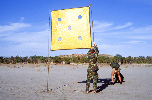 Navy Sea-Air-Land (SEAL) team members set up beach markers for a Marine landing party during Exercise Crisex '81