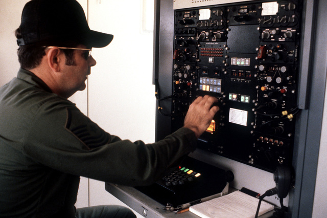 SENIOR MASTER Sergeant Donald M. Wilkerson, 463rd Tactical Air Wing, checks the radio system in the Airlift Control Element building during exercise BOLD EAGLE '82